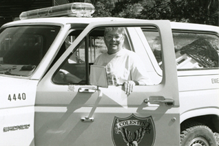 Cheri Avgeris, Aug 1999, with 1440, CRFD's Medical Response rig.