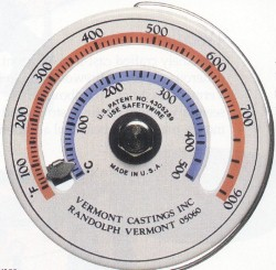 A typical magnetic stovepipe thermometer, marked with maximal burning ranges